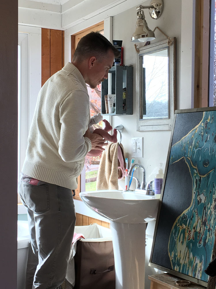 daddy pottying over sink
