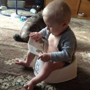 baby reading on potty