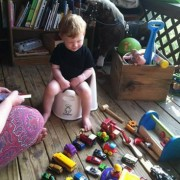 boy on potty with all his cars lined up