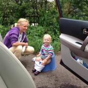 baby potty break outside of car on trip