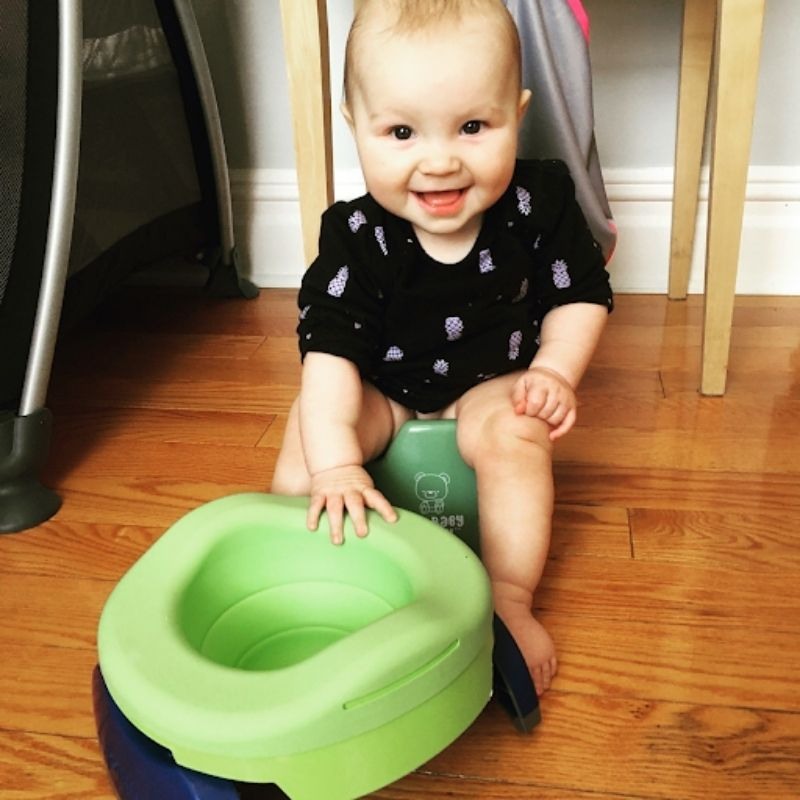 "At 10 months old, my daughter can sit comfortably on her <a href =""http://bit.ly/2MLDQzv"">mini potty</a>."