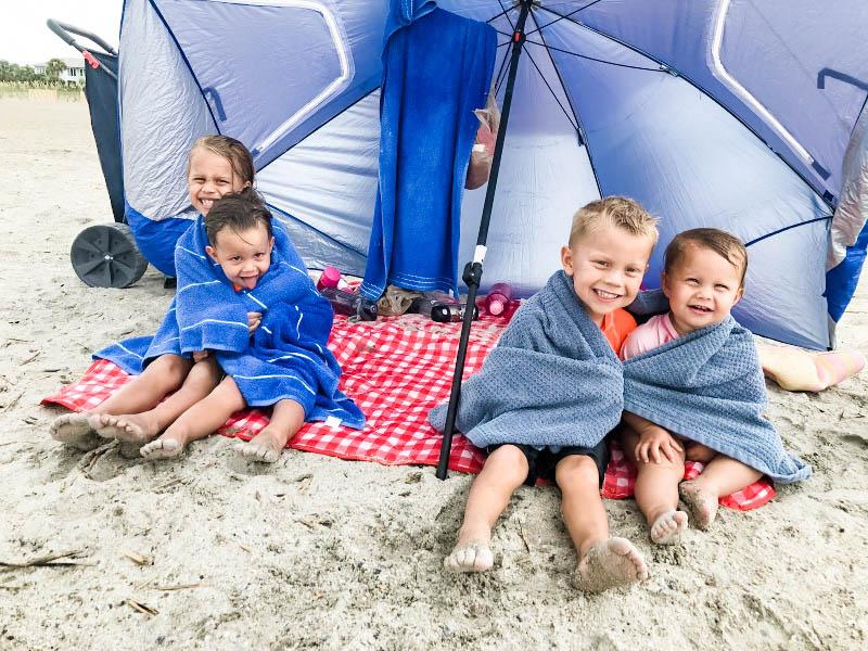 Sunbrella-Sportbrella tent umbrella provides shelter from the wind and the sun at the beach