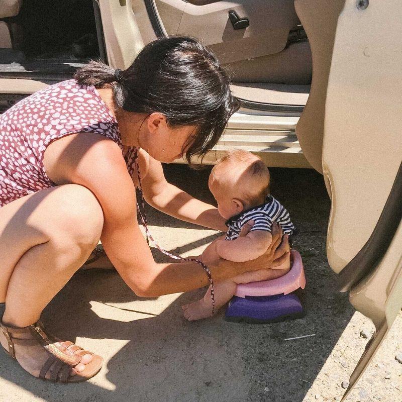 baby ec on potty outside car on roadtrip