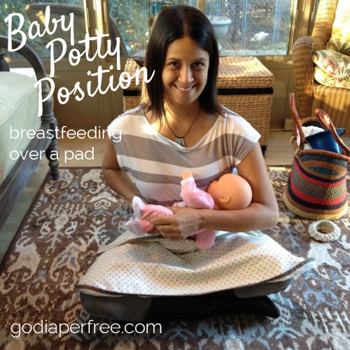 baby potty position - breastfeeding over pad