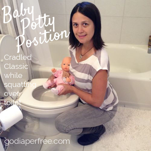 baby potty position - cradled classic squatting over toilet