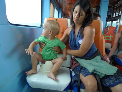 putting baby on potty on boat