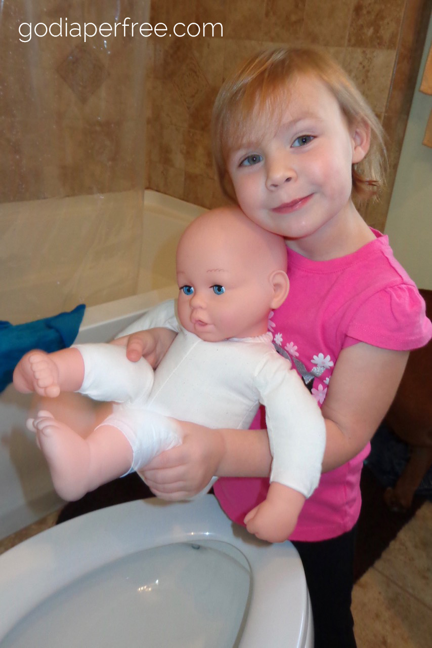 toddler pottying baby doll